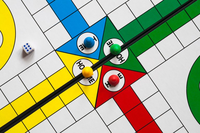 Close up detail of Ludo game with dice and pieces