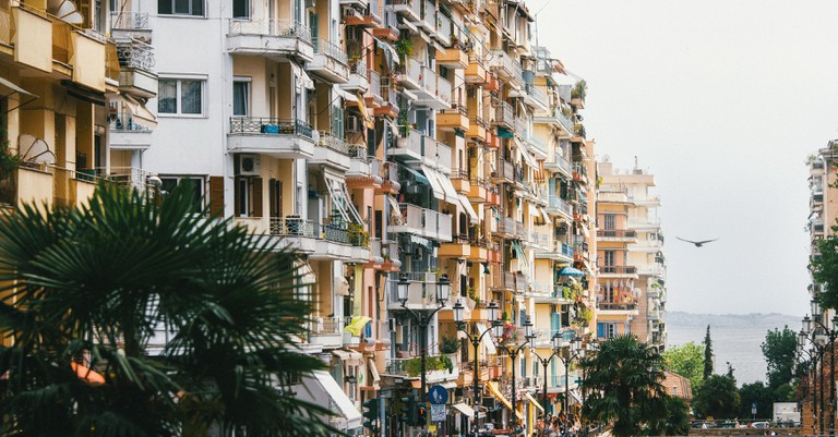 Colourful houses on pedestrian street. Apartment buildings in Thessaloniki, Greece.