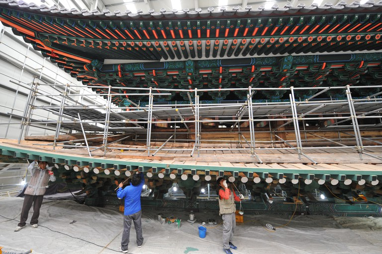 October 9, 2012, Craftsmen restore South Korea's foremost historical treasure, Namdaemun (South Gate), which was engulfed in flames lit by an arsonist on February 10, 2008