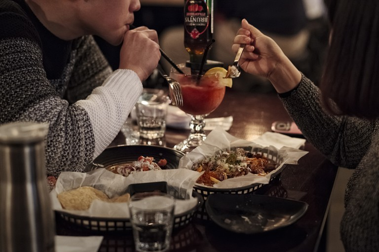 A couple enjoy Mexican dishes at Vatos, a Mexican restaurant in Itaewon in Seoul, South Korea.