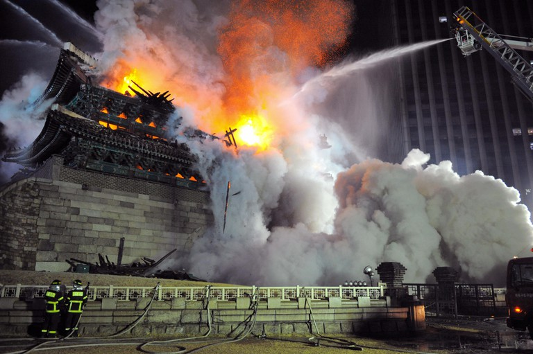 Firefighters battle a blaze at the break down Namdaemun gate, one of South Korea's most historic sites, in central Seoul on early February 11, 2008