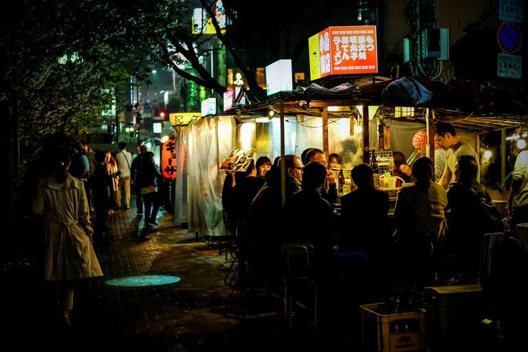 People Enjoying Food at Yatai (Open Air Food Stands) in Fukuoka
