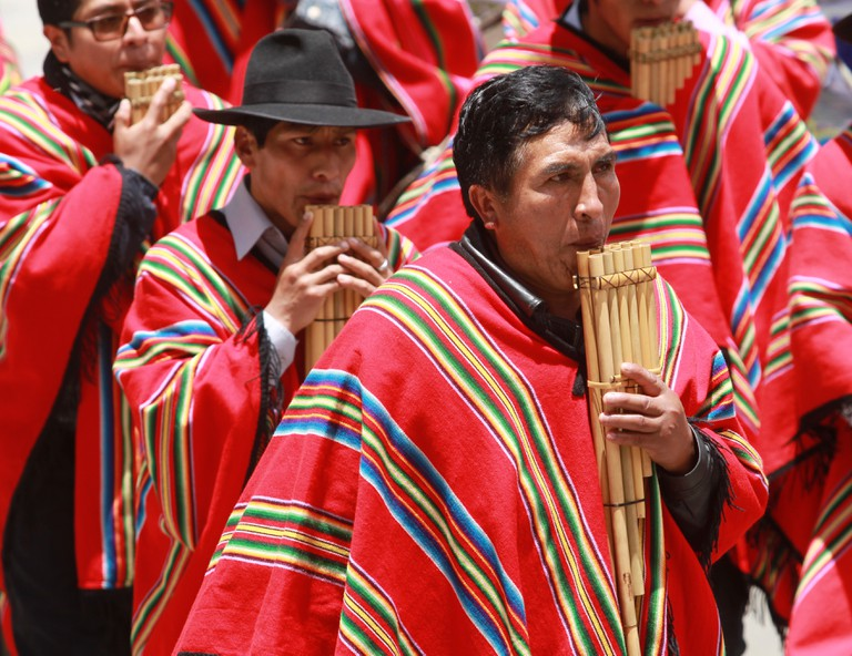 A man plays the panpipe in La Paz