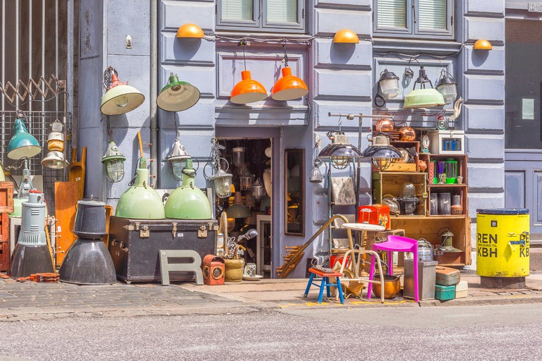 Vintage and second hand shop in Copenhagen. Old and used things for sale on the pavement.