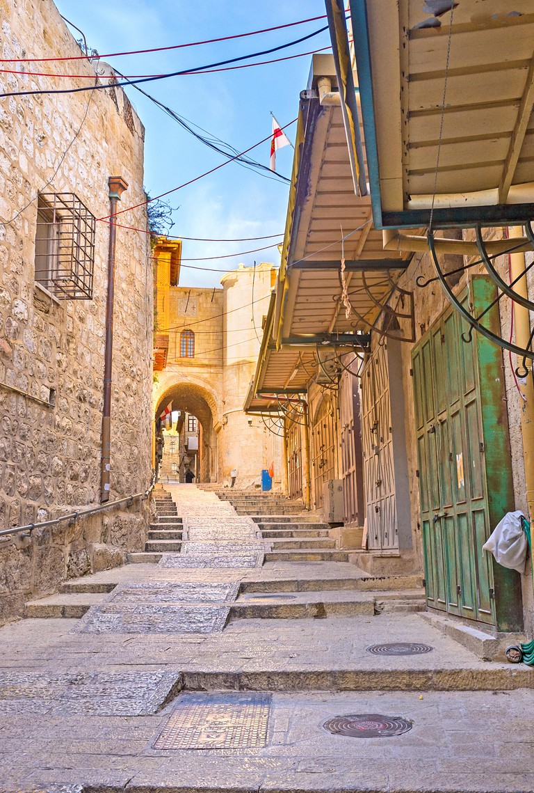 The narrow winding street with the stairs and closed market stalls, Jerusalem, Israel.