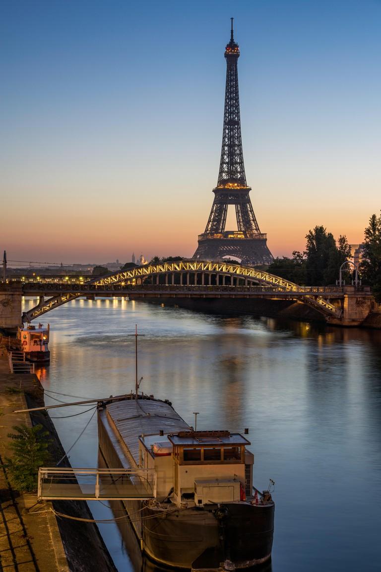 Sunrise on the Eiffel Tower, the Seine River and Pont Rouelle bridge. Paris, France