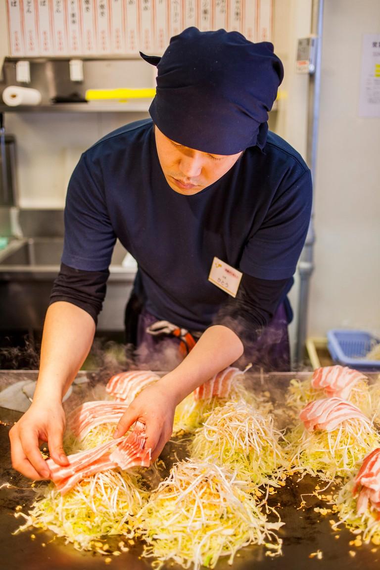 Chef Cooking Okonomiyaki, Hiroshima, Japan