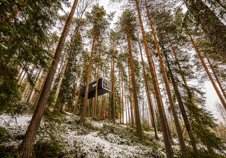 Accommodation in the woods, known as The Cabin at the Tree Hotel in Lapland, Sweden