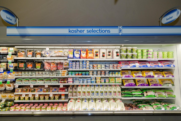 A Kosher refrigerated foods section in a grocery store