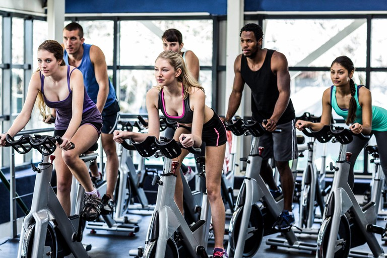 Fit people working out at spinning class. Image shot 01/2016. Exact date unknown.