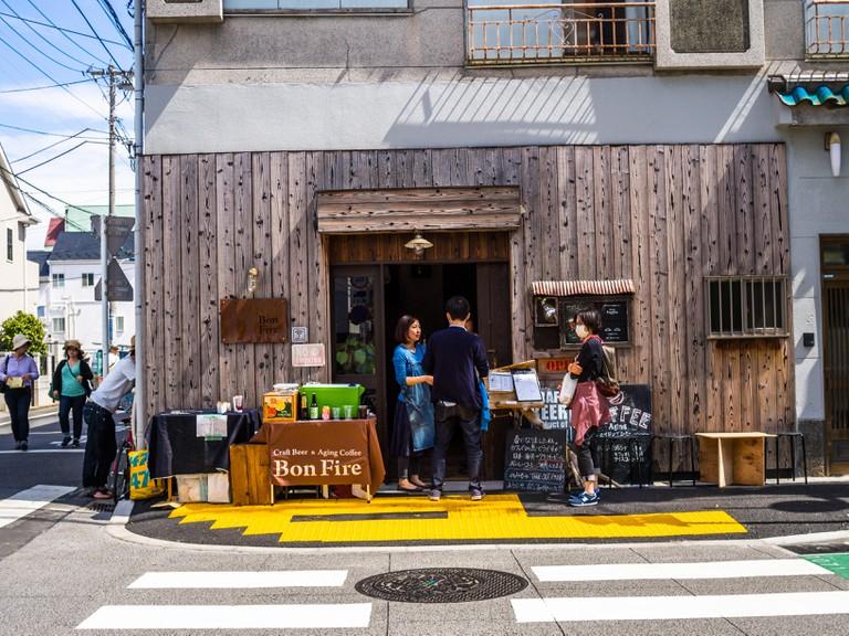 People walking at Komachi-dori Street, in Kamakura in Japan.