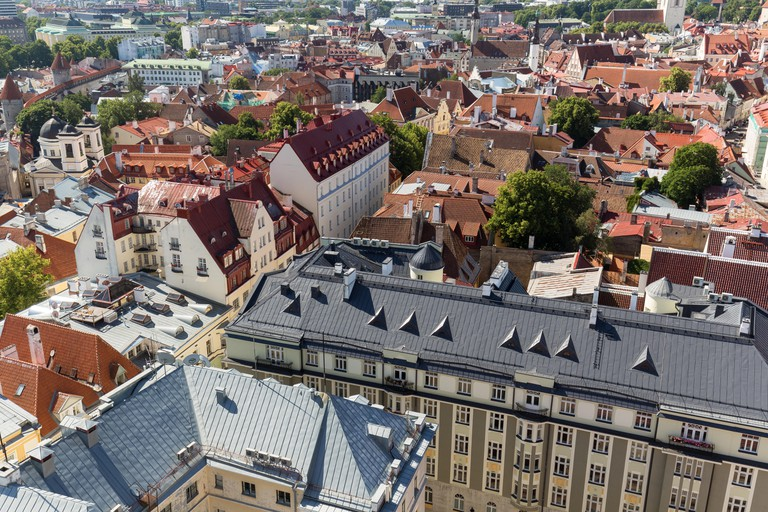 Roofs of old buildings at the Old Town in Tallinn, Estonia, viewed from above on a sunny day in the summer.