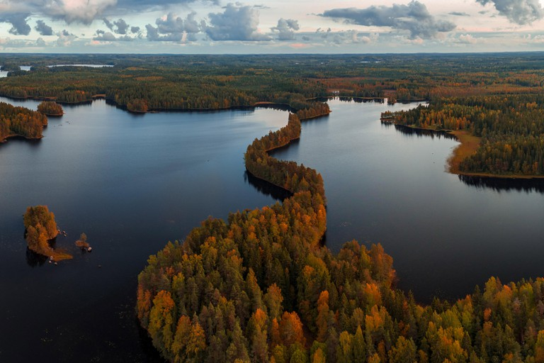 Panorama aerial view from Liesjarvi National Park on an autumn afternoon with sun starting to go down, Finland