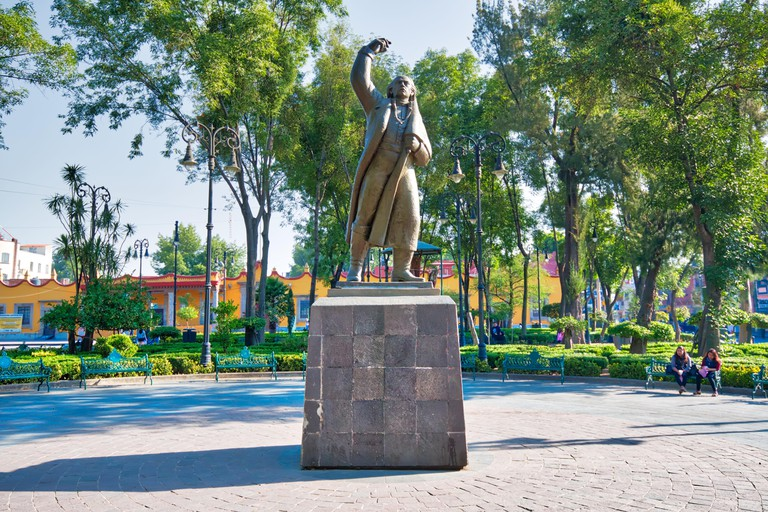 Coyoacan, Mexico City, Mexico-20 April, 2018: Miguel Hidalgo Statue in front of Parish of San Juan Bautista on Hidalgo square in Coyoacan