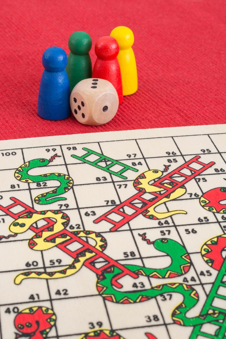 The popular children's game of snakes and ladders centres on the roll of a dice