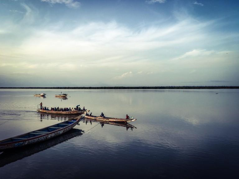 Local pirogues ferry passengers across the Casamance River, Ziguinchor, Senegal