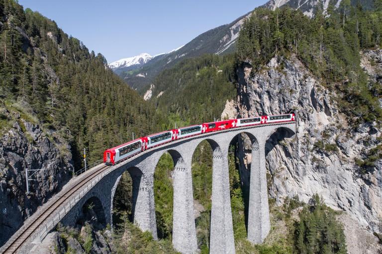 Landwasser viaduct, train of Rhaetian Railway. Filisur, Canton of Grisons, Switzerland.