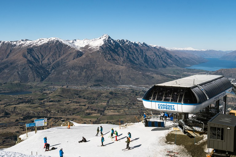 Skiers and snowboarders in ski resort in New Zealand