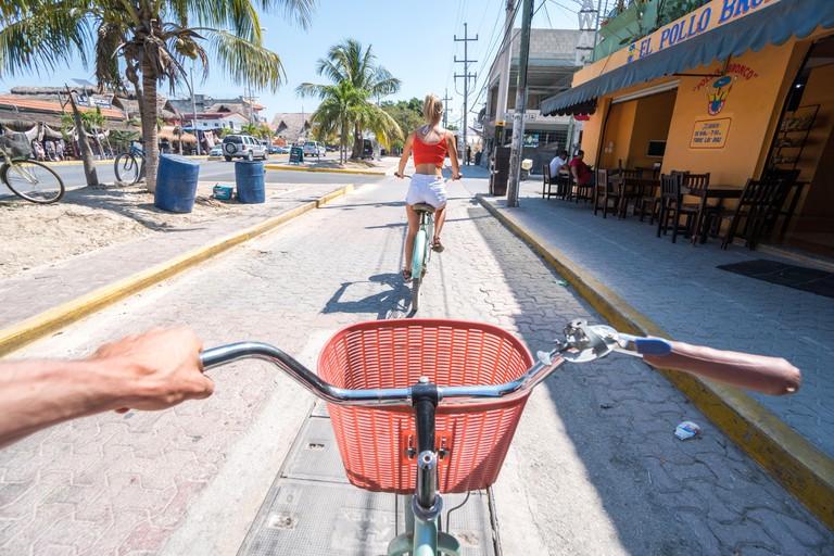 Riding bikes through Tulum