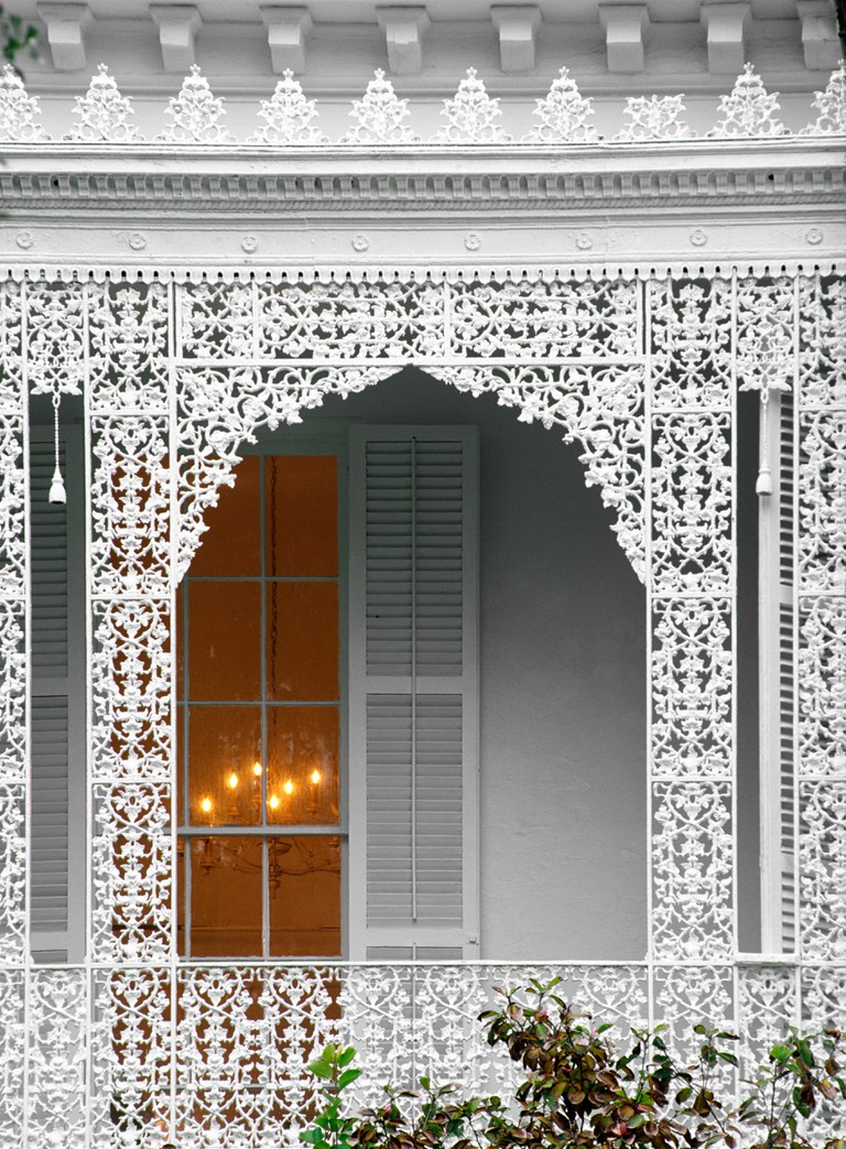 WROUGHT IRON LATTICEWORK of a Southern Style MANSION in the GARDEN DISTRICT NEW ORLEANS LOUISIANA