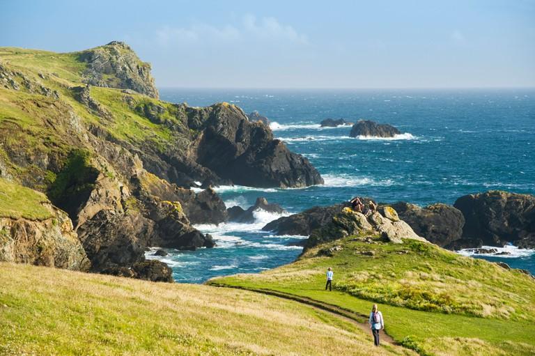 Walkers on the Lizard Peninsula, Cornwall, England.