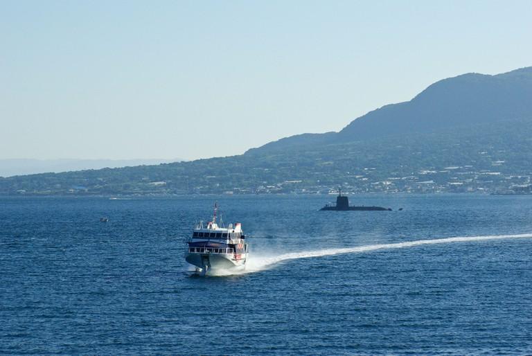 Ferry returning to Kagoshima with Sakurajima in Background, Kyushu, Japan.