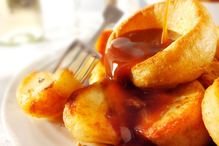 Traditional Yorkshire puddings with onion gravy