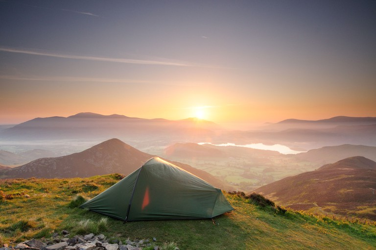 Wild camping under a stunning mountain sunrise in the English Lake District. Pitched on Causey Pike.