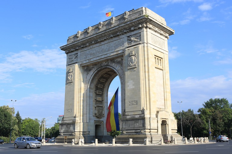 The busy intersection at the Arc de Triomphe in Bucharest, Romania. Image shot 08/2013. Exact date unknown.