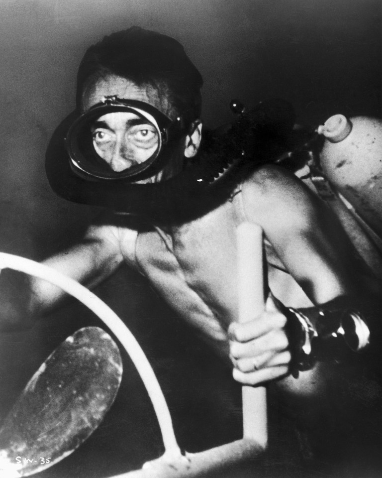 JACQUES COUSTEAU (1910-1997). /nFrench oceanographer. Driving his underwater electric scooter in a scene from his film 'The Silent World,' filmed in 1954-55 and released in 1956.