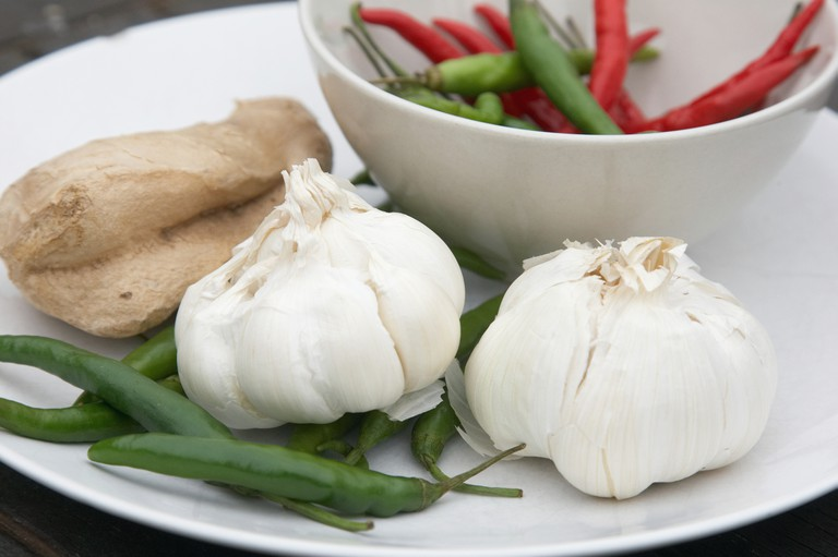 Hot green red chilis with ginger and garlic bulbs