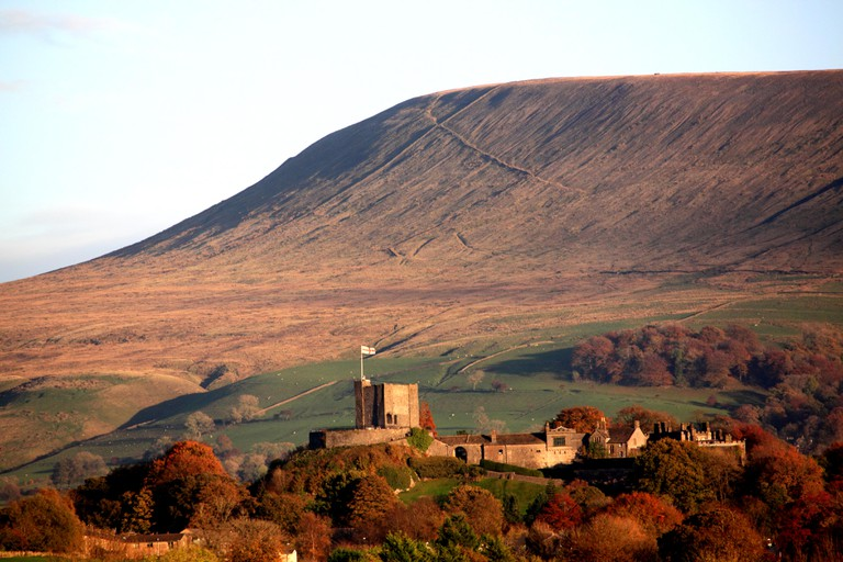 Clitheroe Castle, Lancashire, situated under the brow of Pendle Hill.  Autumn.