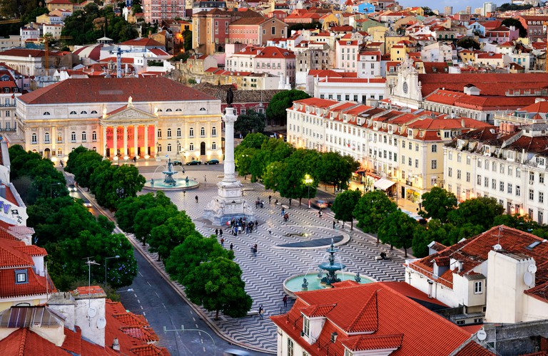 Rossio square or Praca Dom Pedro IV, the heart of the historic centre at twilight. Lisbon, Portugal