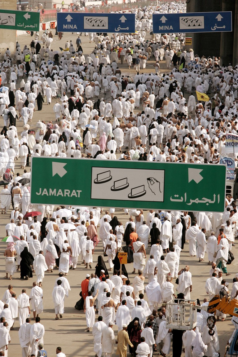 Muslim pilgrims head to stone one of three pillars in a ritual called 'Jamarat,' symbolizing stoning the devil, in the Mina Valley, near Mecca, Saudi Arabia on December 7, 2008. More than two million Muslims head to the holy city of Mecca to make the annu