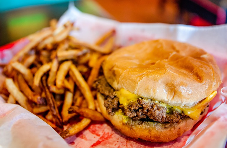 A cheeseburger and french fries is served in a basket at Dyer?s Burgers, Sept. 12, 2015, in Memphis, Tennessee. Dyer?s opened in 1912.