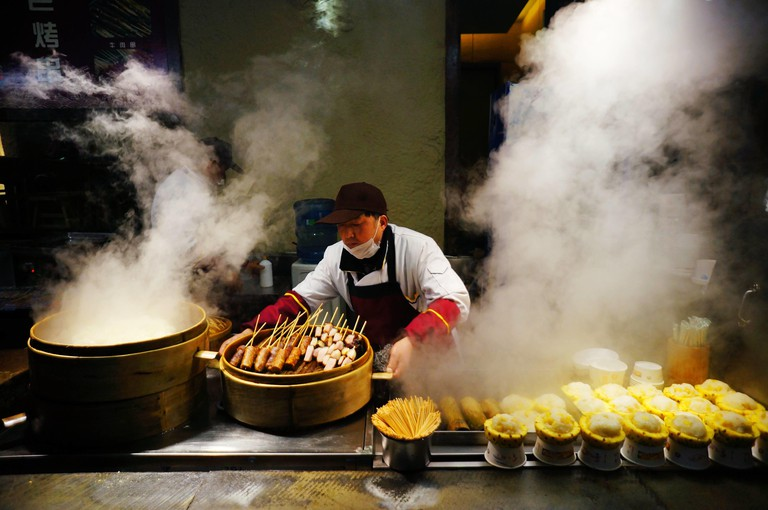 A chef serves snacks at Wide and Narrow Alleys in Qingyang district, Chengdu.