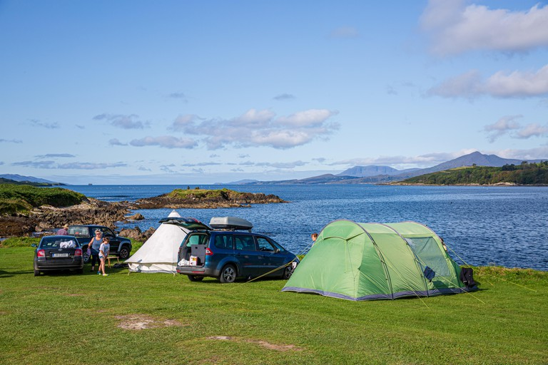 Family camping at the Eagle Point Camping site near Bantry, West Cork, Ireland