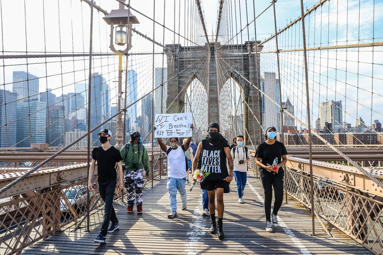 New York, United States. 29th May, 2020. Protesters walk on the Brooklyn Bridge during a Black Lives Matter protest in outrage after George Floyd, an unarmed black man, died after being arrested by a police officer in Minneapolis who pinned him to the flo