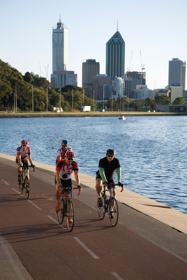 Cyclists on the Perth riverside. Perth, Western Australia.