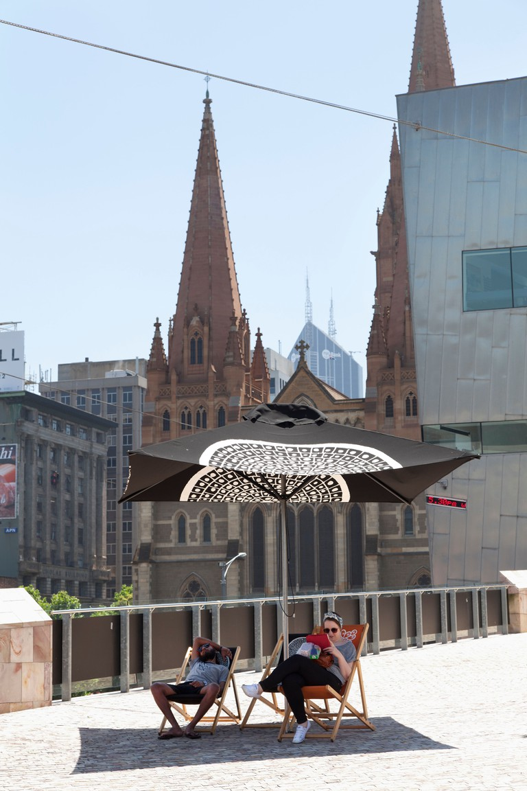 Couple relaxing at Federation Square, Victoria, Australia.