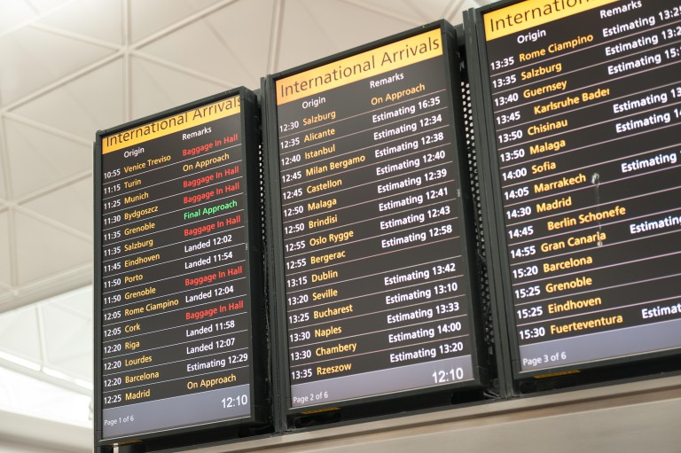 International arrivals board at Stansted Airport, Essex