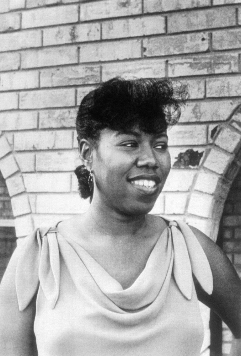 Ruby Bridges Smiling Outside Arched Building