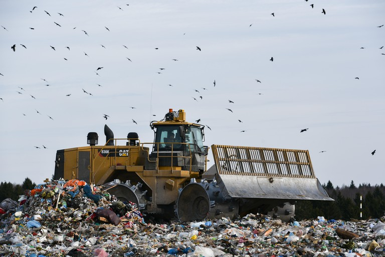 Bulldozer at the Yadrovo landfill site in Moscow Oblast, Russia