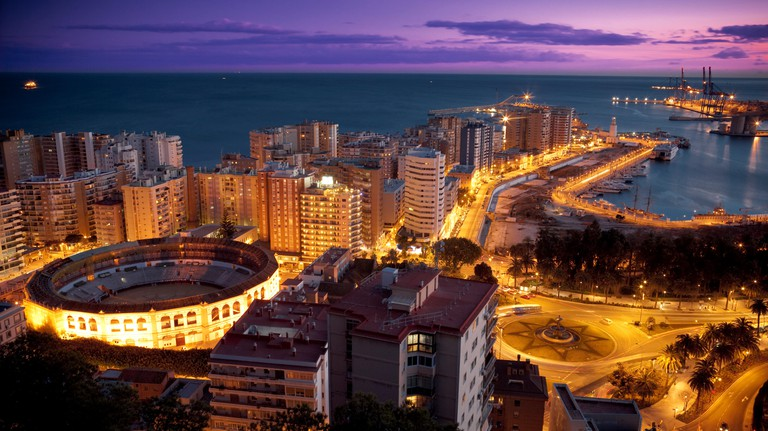 Malaga skyline at night, including bullring and harbour, Malaga, Andalucia, Spain, Europe