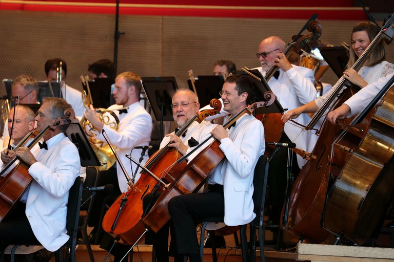 Musicians of Grant Park Symphony Orchestra perform on the stage