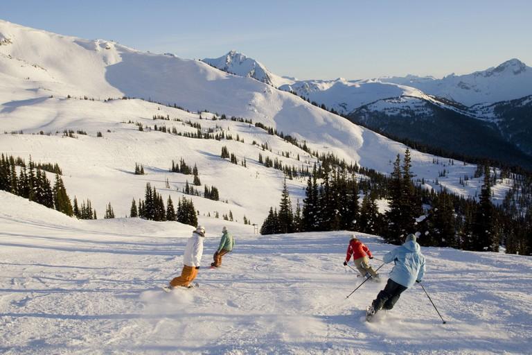 Enjoying skiing on groomed runs Whistler British Columbia Canada