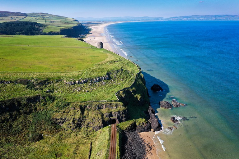 Aerial photograph of Mussenden Temple and Downhill Strand in County Derry