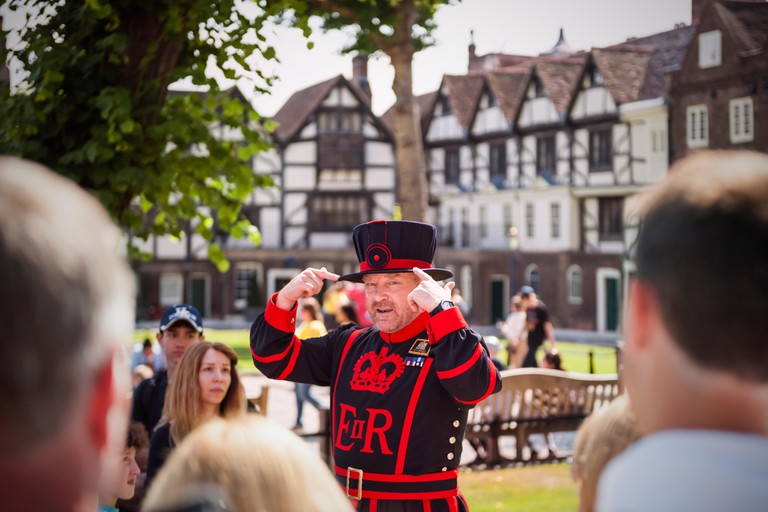 Beefeater conducting a tour at the Tower of London