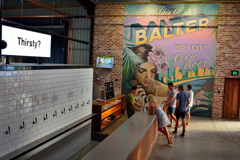 Currumbin, Gold Coast, Queensland, Australia - January 12, 2018. Interior view of Balter microbrewery pub in Currumbin, with people by bar counter.
