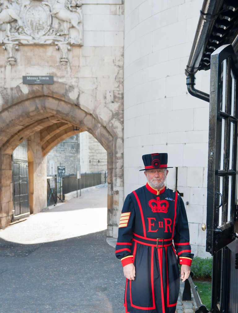 Yeoman guard or Beefeater at the gates of the Tower of London